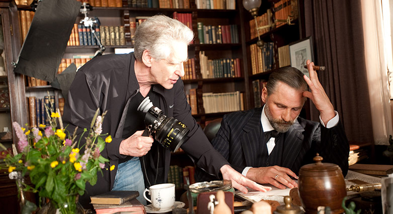 David Cronenberg directs Viggo Mortensen in this behind-the-scenes image from A Dangerous Method.