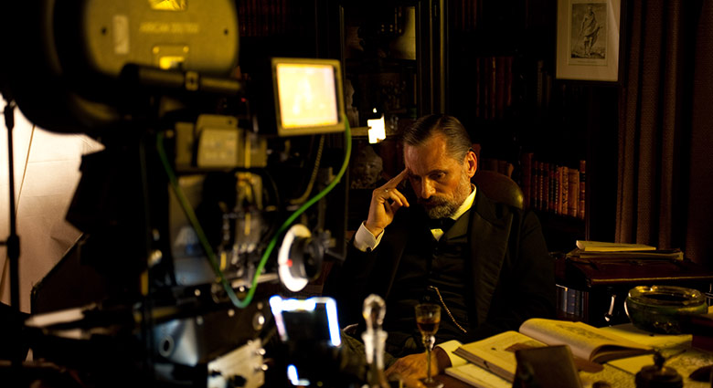 On set with Viggo Mortensen as Dr. Sigmund Freud, in this behind-the-scenes image from A Dangerous Method.