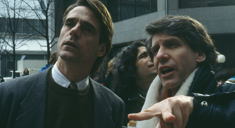 David Cronenberg directs Jeremy Irons on the set of Dead Ringers in Toronto.