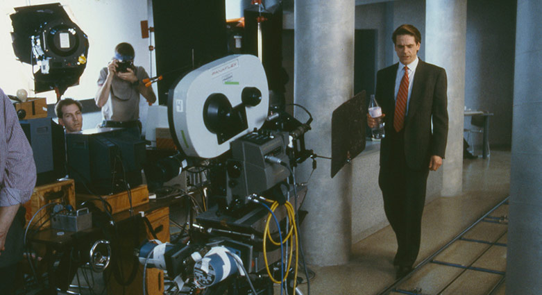 Jeremy Irons walks in front of the motion control camera on the set of Dead Ringers.