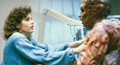 Veronica Quaife (Geena Davis) is attacked by Brundlefly (Jeff Goldblum) in a scene from The Fly.