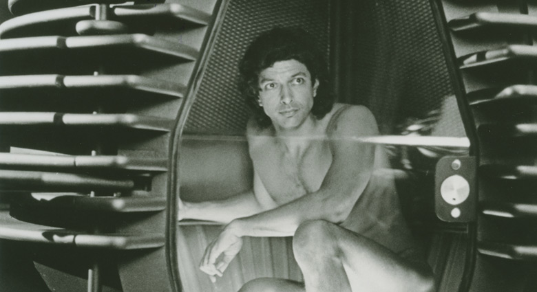 Jeff Goldblum crouches in the skeleton on the pod from The Fly.