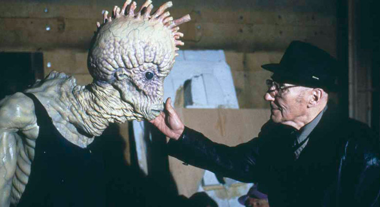 Author William S. Burroughs interacts with a mugwump on the set of Naked Lunch.