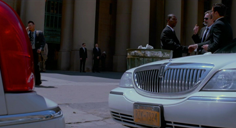 Eric Packer (Robert Pattinson) stands with his bodyguard (Kevin Durand) in front of Toronto's Union Station in Cosmopolis.