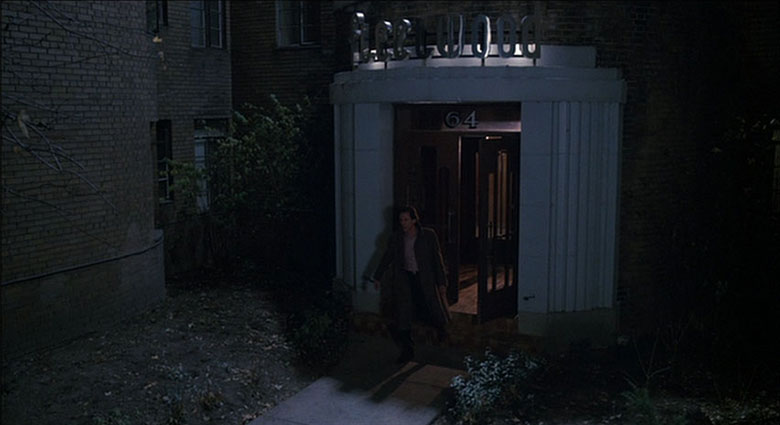 Max Renn exits his Toronto apartment building in Videodrome.