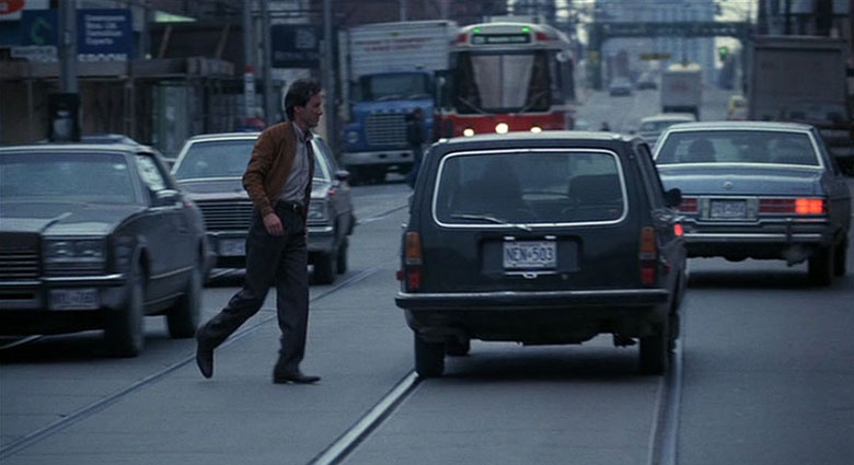 Max Renn (James Woods) meets Barry Convex (Leslie Carlson) on Queen St. E. in Videodrome.