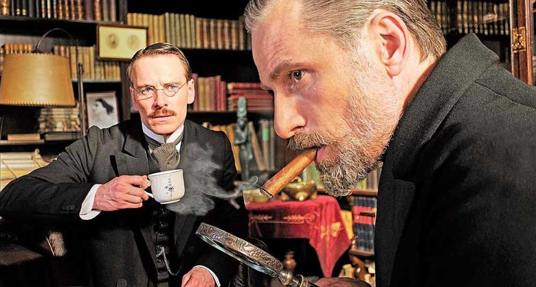 Psychologist Carl Jung (Michael Fassbender) looks up to his mentor, Sigmund Freud (Viggo Mortenson), in A Dangerous Method.