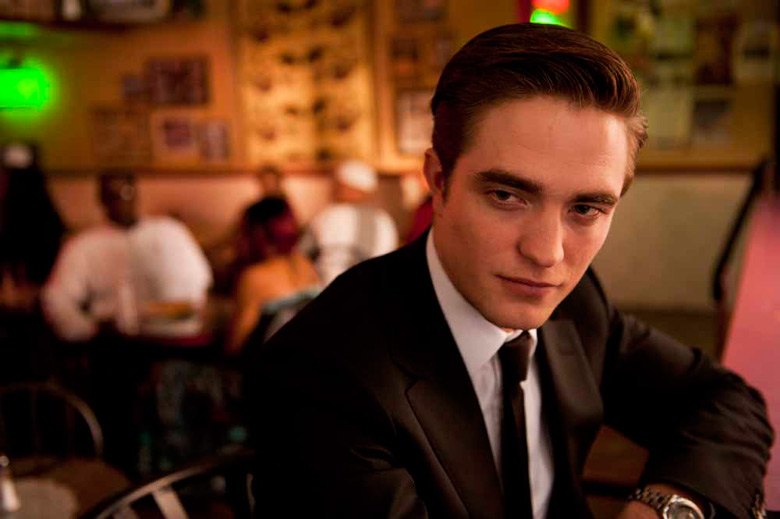 Billionaire Eric Paker (Robert Pattinson) dines at a restaurant in a scene from Cosmopolis.