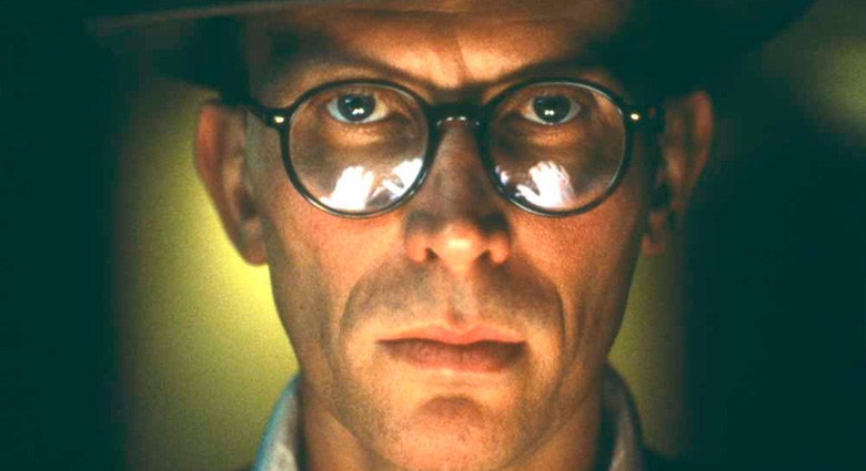 The hands of Naked Lunch protagonist Bill Lee (Peter Weller) are reflected in his glasses.