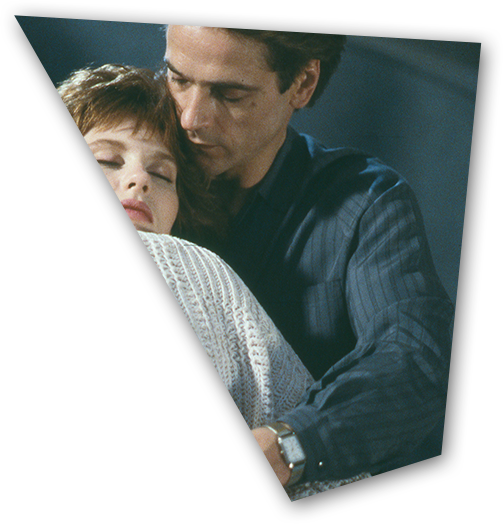 An embrance is shared between Cary (Heidi von Palleske) and the fated Mantle twins (Jeremy Irons) in Dead Ringers.