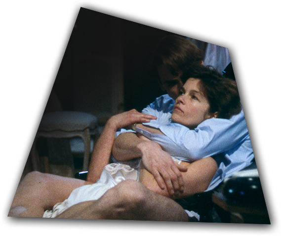 Lovers Claire Niveau (Geneviève Bujold) and Beverly Mantle (Jeremy Irons) are intertwined in a scene from Dead Ringers.