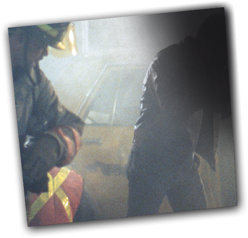 Vaughan (Elias Koteas) documents a fatal car accident in a scene from Crash.